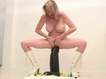 mature with huge boobs,big tits milf,mature rides on a colossal dildo,monster sized toy penetrated into pussy