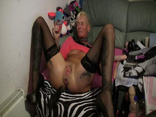 horny milf dildo rides,penetrated huge toy into pussy,awesome blonde with tattooed body,piercing pussy,extreme whore dildo penetrated herself,solo dildo fuck perverse slut