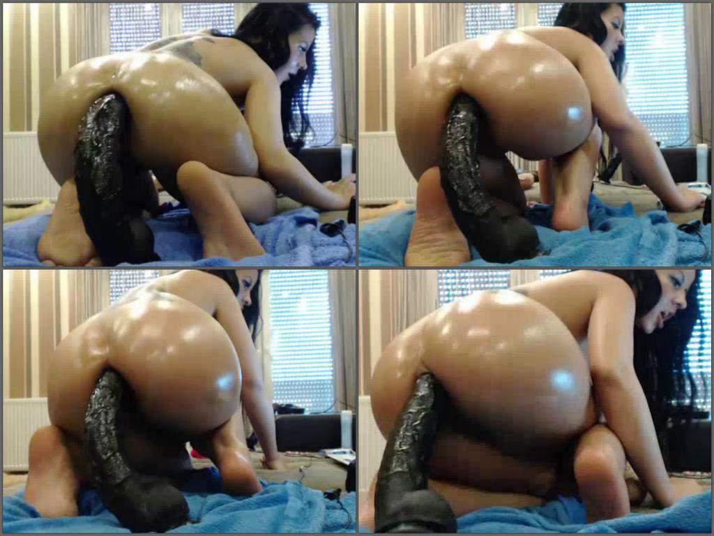 booty tattooed brunette insertion monster dildo in ass