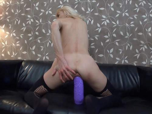Mature with silicone boobs riding on a huge dildo