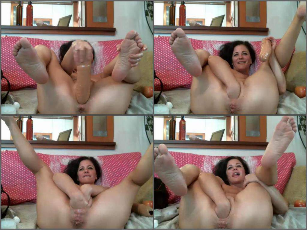Beautiful girl fisting toy brunette down