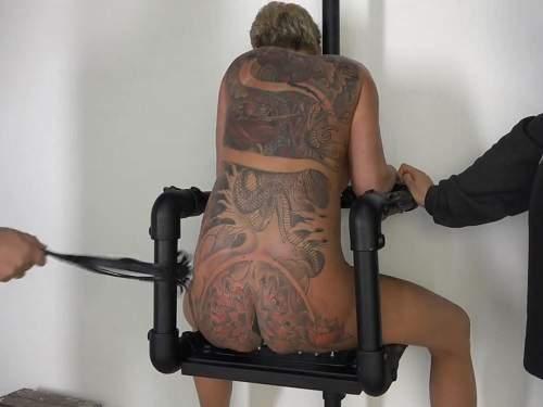 tattooed mature,sexy tattooed milf,mature sits on a spikes,mature sitting on the iron spikes,tattooed milf gets domination,spanking