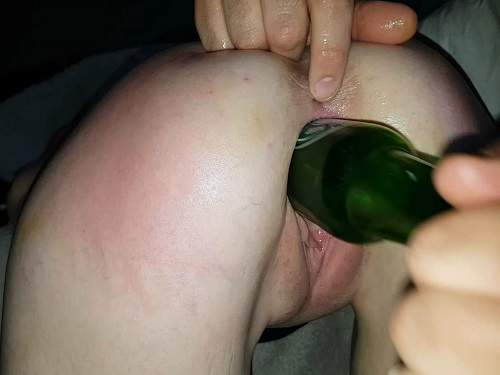 Amateur wife gets bottle and fist in her gaping pussy
