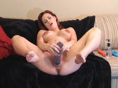 Pregnant women playing with a dildo — photo 6